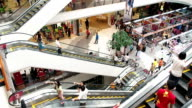 Timelapse of busy escalators in shopping mall video