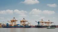 Timelapse of cargo ship loading goods at shipping port, 4K(UHD) video