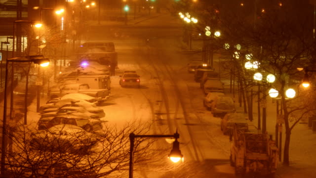 Timelapse of Cars Moving on Snow-covered Streets in a City during a snowstorm. video