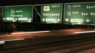 timelapse of cars under Hollywood freeway sign video