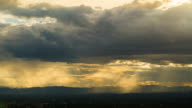 Timelapse of Clouds and Stormy Night with sun rays video