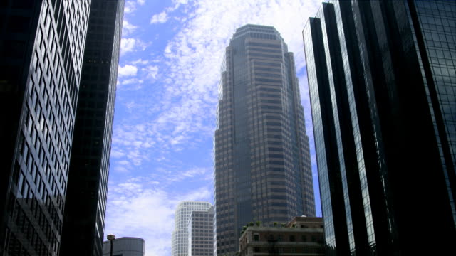 Timelapse of clouds moving over skyscrapers video