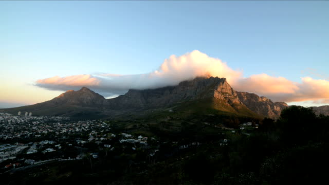 Timelapse of clouds moving over top of Table Mountain in Cape Town, South Africa, day to dusk video