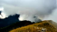 Timelapse of clouds rising up the mountains, colorful autumn landscape video