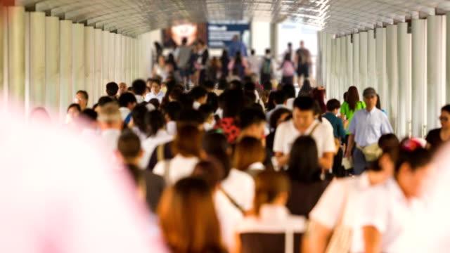 Timelapse of Crowd people walking on the Bridge walkway video