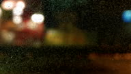 Timelapse of defocused night traffic lights in rain. video