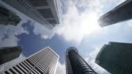 Timelapse of Directly below shot of skyscrapers against sky video
