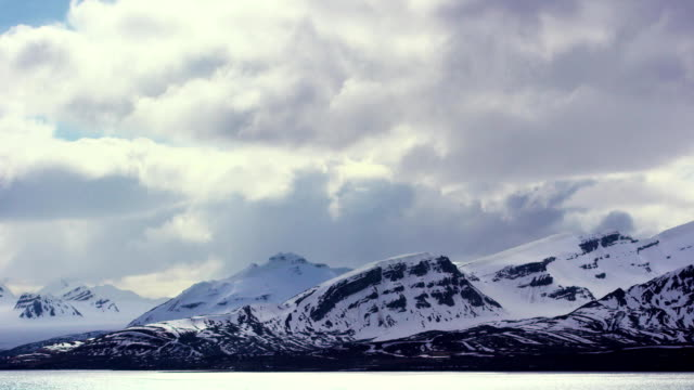 Timelapse of dramatic clouds over mountains in the arctic video