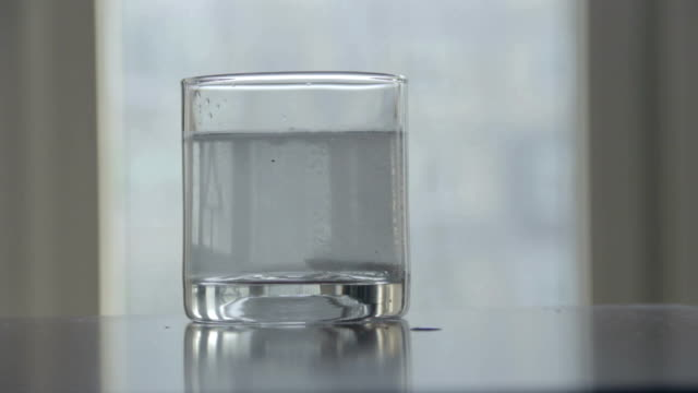 Timelapse of effervescent tablet dissolving in water glass sound video