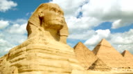 Timelapse of famous Sphinx with great pyramids in Giza valley video