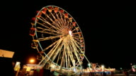 Time-lapse of Ferris Wheel at amusement park at a night time video