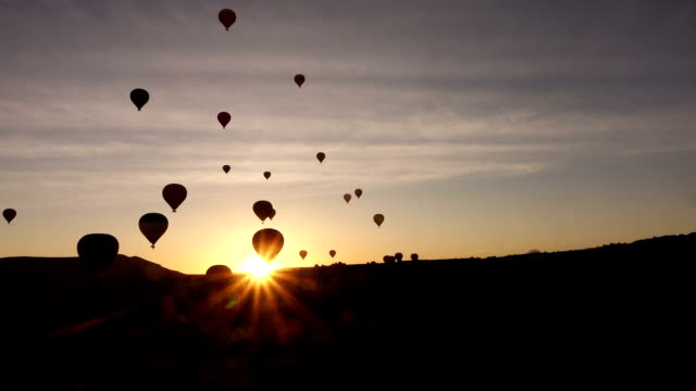 timelapse of hot air balloons in the air from within the valley in Cappadocia video