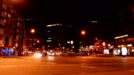 Time-lapse of intersection in evening with traffic lights and cars video