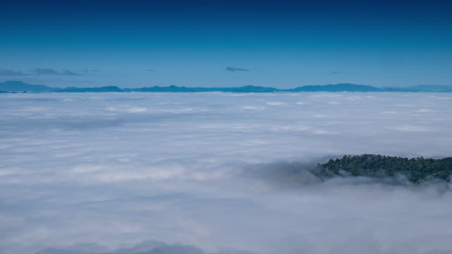 Time-lapse of mountain and moving mist with blue sky , 4k(UHD) video