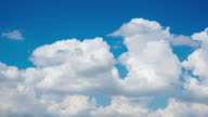 Timelapse of moving clouds and blue sky in summer with sunshine in day time video