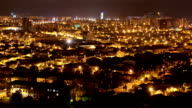 Timelapse of night illuminated cityscape view of city streets modern buildings in Batumi, Georgia video