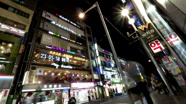 Timelapse of night street with illuminated banners on the buildings. Seoul, South Korea video