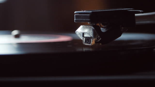 Time-lapse of Record player turntable. A record player turntable with it's stylus running along a vinyl record video