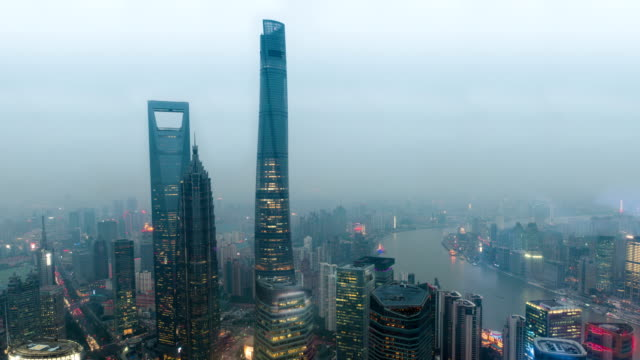 Time-lapse of Shanghai's three tallest skyscrapers, the Shanghai World Financial Center, the Jin Mao Tower, and the Shanghai Tower at sunset video