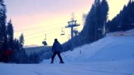 Timelapse of Ski chair-lift with skiers in snow-capped mountains at Austrian Alps video