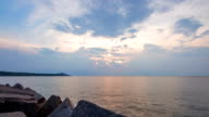 Timelapse of Sun Setting Through Clouds Over Lake Erie video