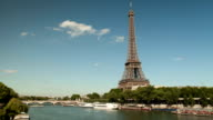 Timelapse of the Eiffel tower and the Seine with tourist boats video