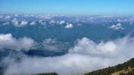 Timelapse of the mist cloud on peak of Mountain. view foggy in morning on background. video