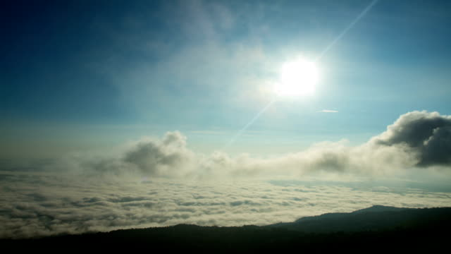 Timelapse of the morning sun and clouds with fog video