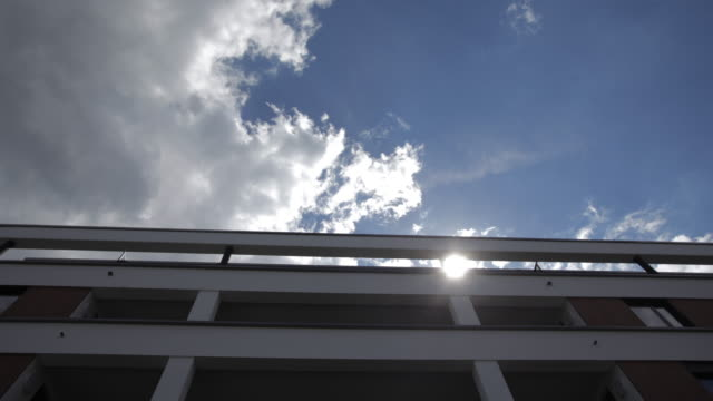Time-lapse of the Sky and Clouds Above a Building video