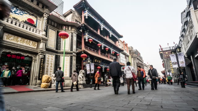 Timelapse of the visitors roaming at the Dashilanr pedestrian street, Beijing, China video