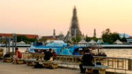 Time-lapse of tourists with Wat Arun across the Chao Phraya River video