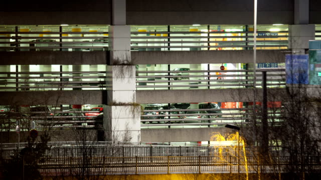 Timelapse of traffic near parking deck at night video