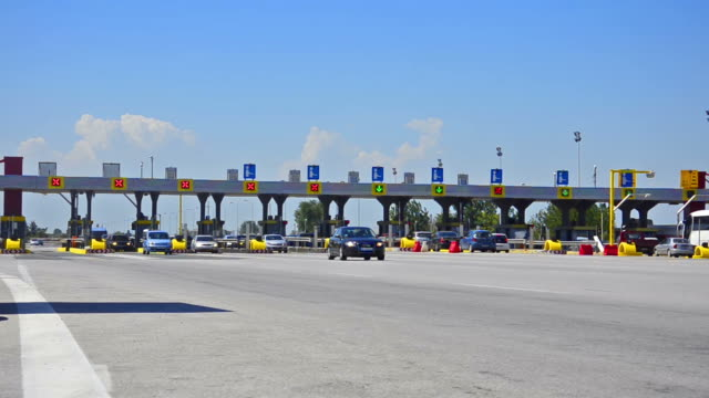 Timelapse of traffic passing through the toll plaza at vacation season video
