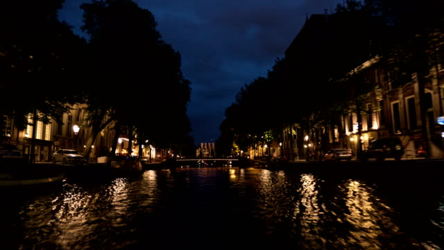 Timelapse of traveling on Amsterdam canals at night video
