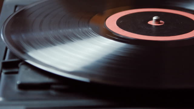 Time-lapse of Vinyl rotating on a turntable, top view video