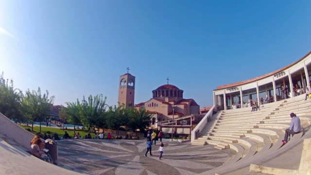 Timelapse of Visitors at Thessaloniki Mediterranean Cosmos mall taking break and meal at amphitheater stairs video