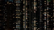 Timelapse of window lights in high-rise apartment block at night video