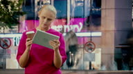 Timelapse of woman with touch pad in crowded street video