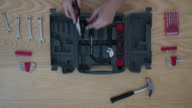 Time-lapse of Worker toolbox and tools overhead angle video