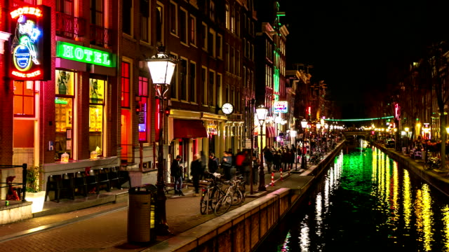 HD Time-lapse panning: Tourist Amsterdam Red Light District night video