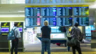Timelapse : Passengers checking the flight schedule video