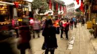 HD Time-lapse: Pedestrian Crowd at Ciqikou Ancient Park Chongqing, China video