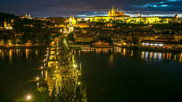 4K Time-lapse: Pedestrian Crowded Charles Bridge Czech aerial at dusk video
