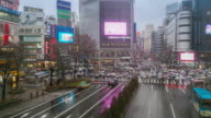 Time-lapse: Pedestrians at Shibuya Crossing with raining video