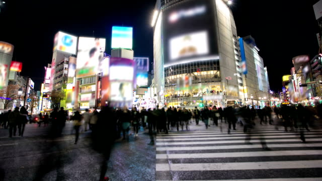 HD Time-lapse: Pedestrians cross at Shibuya Crossing video