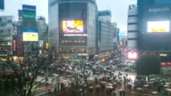 HD Time-lapse: Pedestrians cross at Shibuya with raining at dusk video