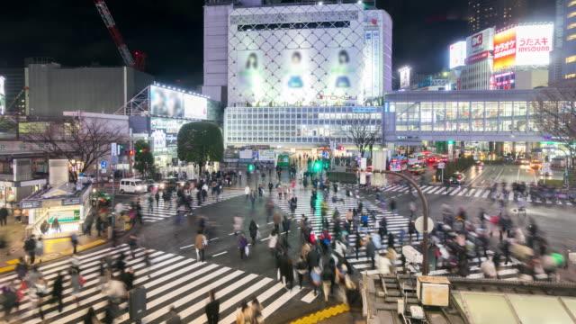 4K Time-lapse: Pedestrians cross at Shibuya with raining at night video