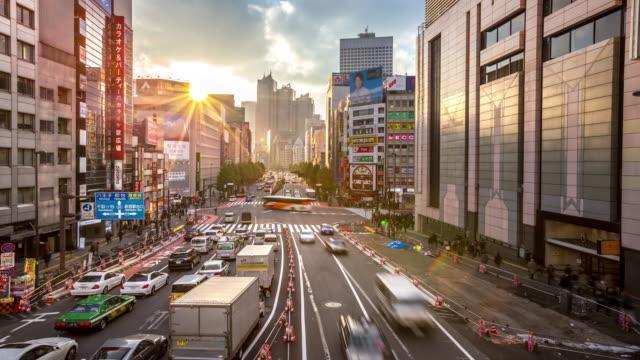 4K Time-lapse: Pedestrians crowded at Shinjuku station Tokyo sunset video