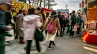 HD Time-lapse: Pedestrians shopping at Fushimi Inari Market Kyoto video