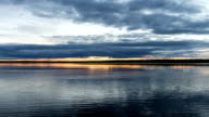 Time-lapse photography sunset and clouds over the river in Siberia, white nights video